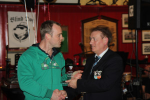 Dave Dennehy receives Third's Player of the Year Award from President Dr Michael O'Flynn, Old Crescent RFC President's Awards Night, 15 May 2015