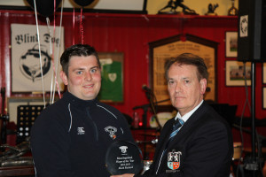 Mark Rickard receives Most Improved Player of the Year Award from President Dr Michael O'Flynn, President's Awards 2014-15, 15 May 2015