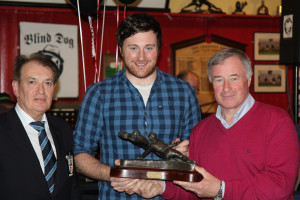 Sean Monaghan receives his First Team Player of the Year Award from sponsor Bill Hanly, Hanly Donnellan Auctioneers, with Dr Michael O'Flynn, President, Old Crescent RFC